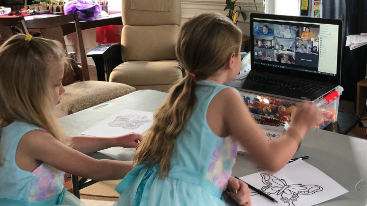Two kids participating in virtual Sunday School